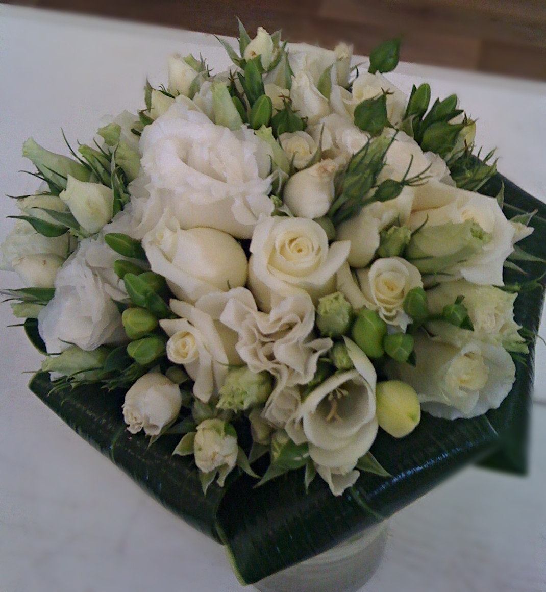 White bouquet of roses, tulips, freesia,lisianthus, and spray roses