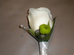 Rose button hole with berries and chryies bud