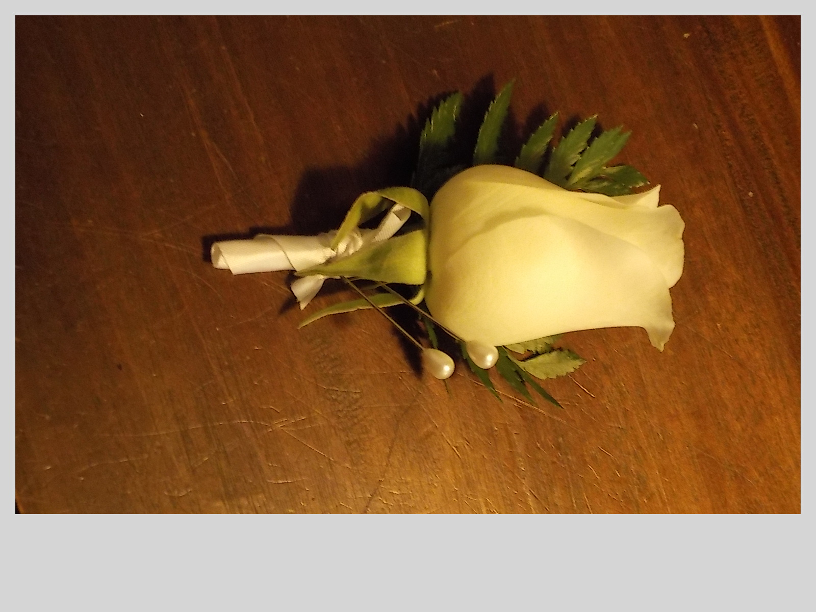 White rose Grooms button hole