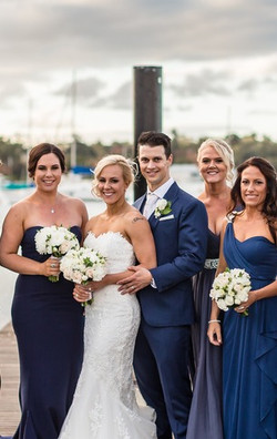 Bridal party on the jetty. White and cream flowers_edited.jpg