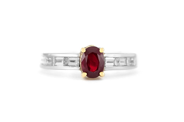 Engagement Ring with Oval Cut Ruby and Diamonds