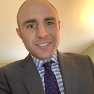 Chris Romaka (Legal Intern)