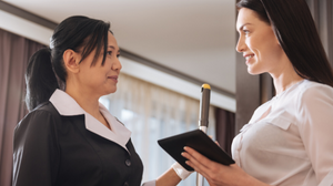 Hotel staff and guest speaking in hotel room