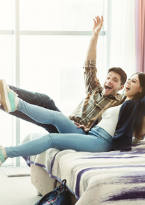 Happy guest couple in hotel room