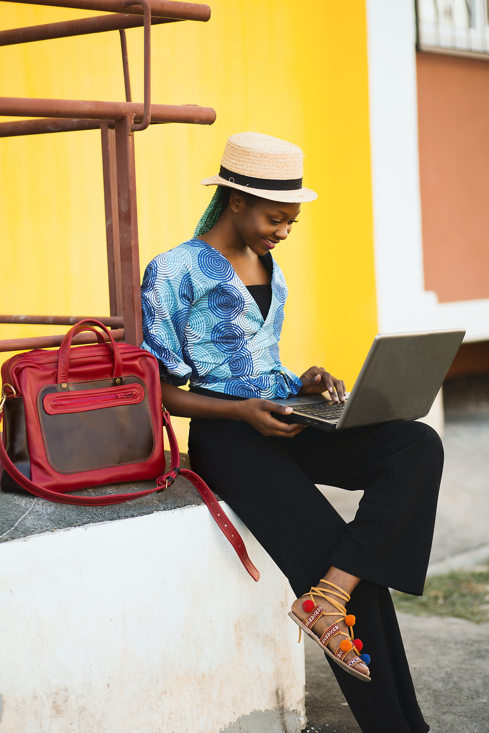 happy woman traveller with laptop