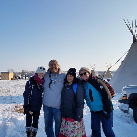 At Sanding Rock with fellow protesters Meredith Parker, Cecil Lopez, and Julie LaBrake