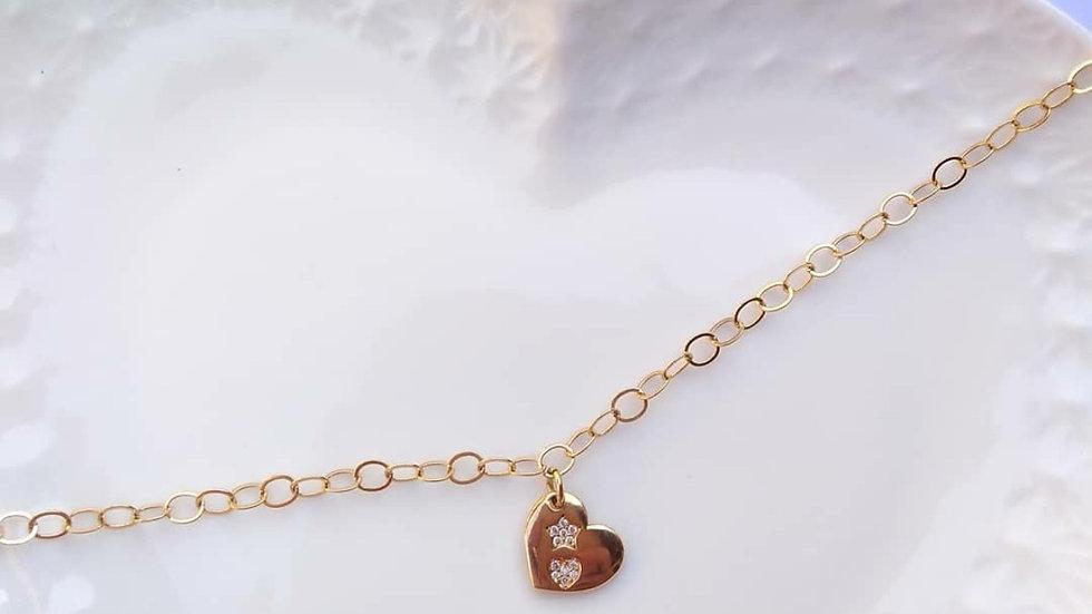 Pulseira banhada a ouro 18 k com pingente de coração com detalhes em strass( cor