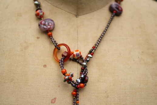 Lariet with lampworked glass beads-Lavender and Red Orange