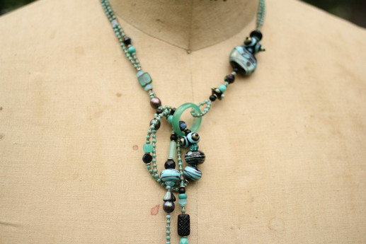 Lariet with lampworked glass beads- Seafoam green and Black