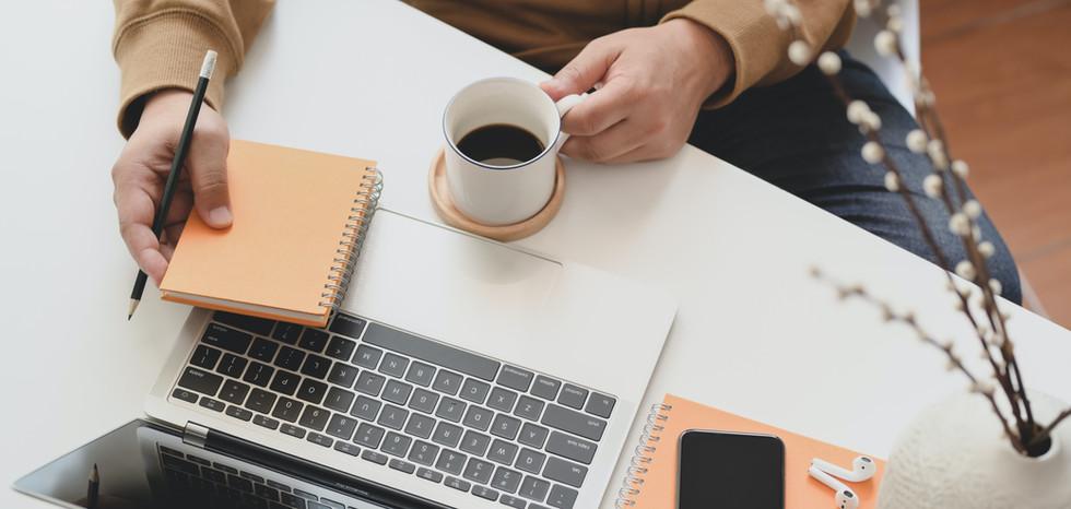 person-holding-white-ceramic-mug-beside-