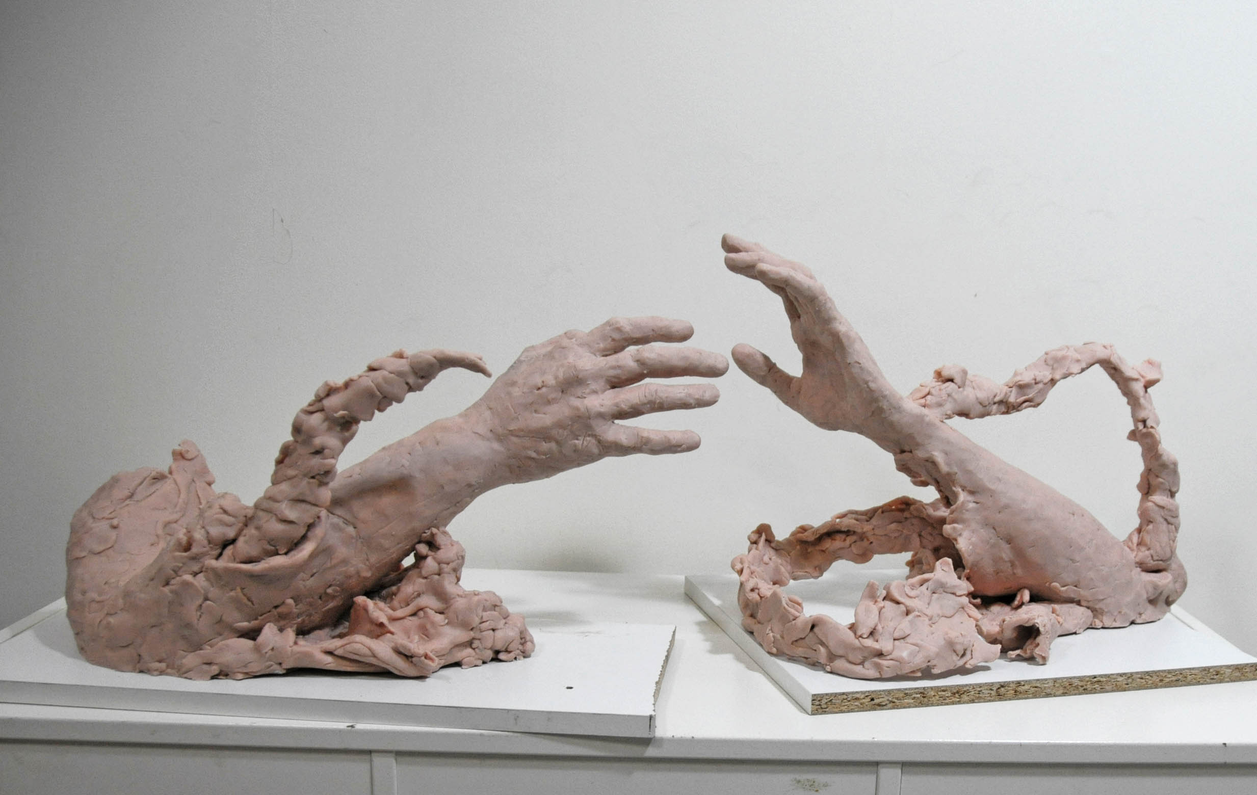 The reach. Male and female hands.