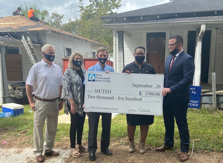 East Mississippi Realtors presents check to MUTEH