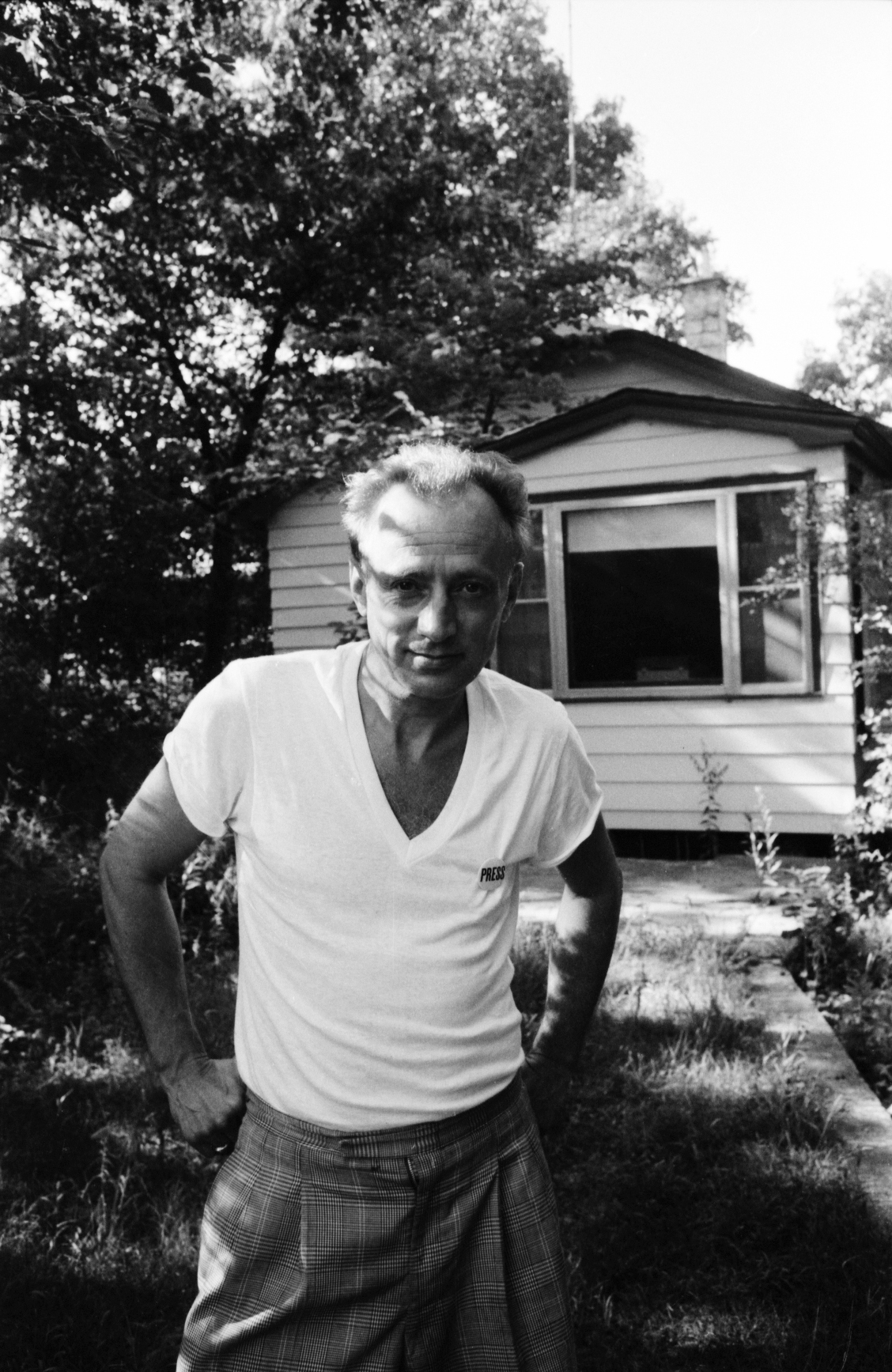 Algren in front of beach cottage