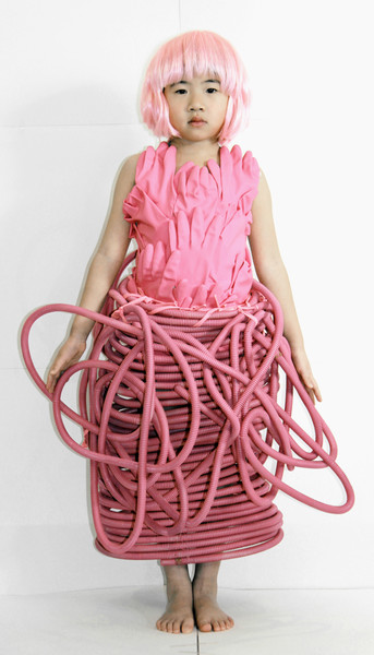 Tangled pipes represent blood vessels which symbolize blood relationship. The child is entangled by the love from her parents or relatives.