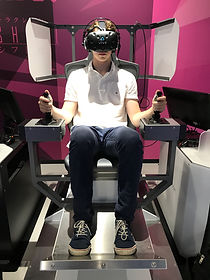 Kent sitting in a VR robot contraption at the VR Zone in Shinjuku, Toyo