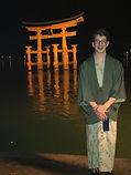Kent standing in front of Itsukushima Shrine on Miyajim