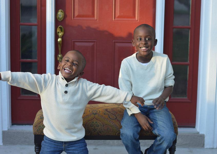 Boys on porch with khaki jeans.jpg