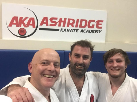 Lloyd taking his 4th Kyu grading with Ryan lending a helping hand (and foot)
