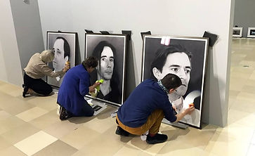 Art Handlers Installers Touch Up Artwork Surfaces Prior to Installation at Exhibition