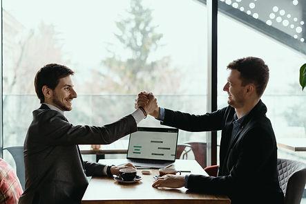 two-business-men-celebrating-a-deal.jpg