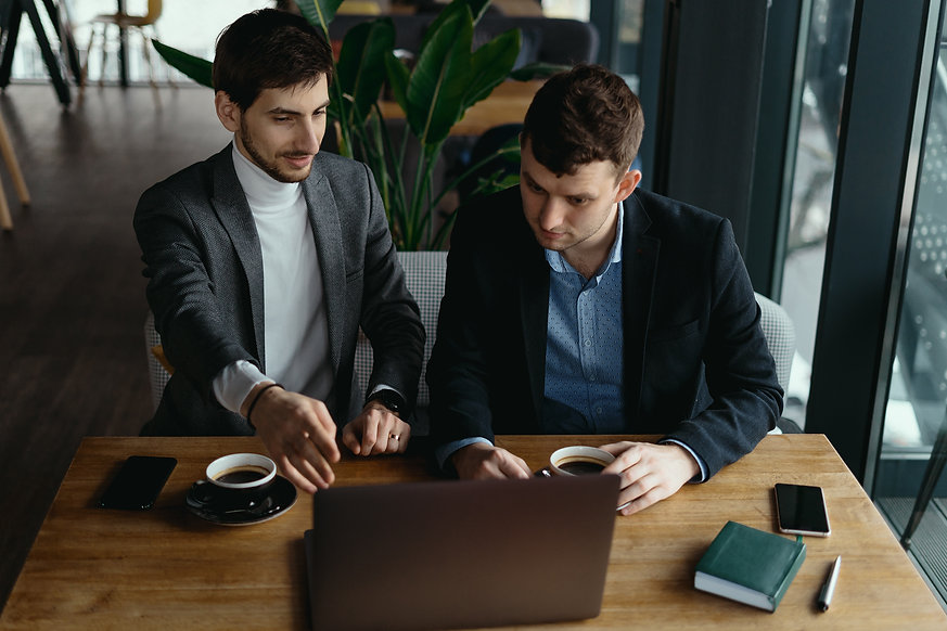 two-businessmen-pointing-laptop-screen-w