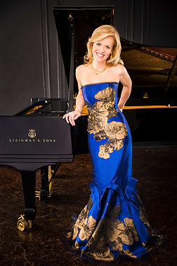 standing by piano blue w gold dress kern
