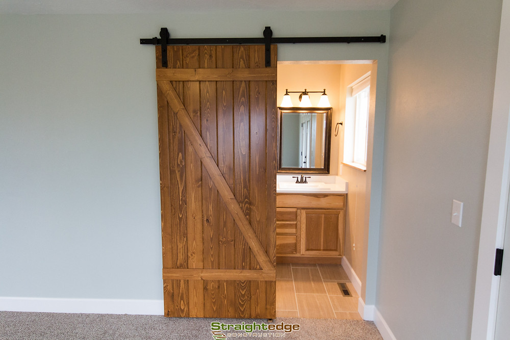 Handmade wooden farm door by Straightedge Construction