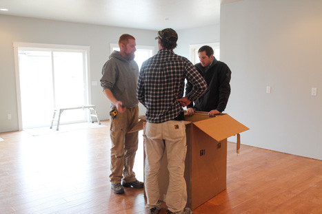straightedge construction workers talking in a Missoula new home