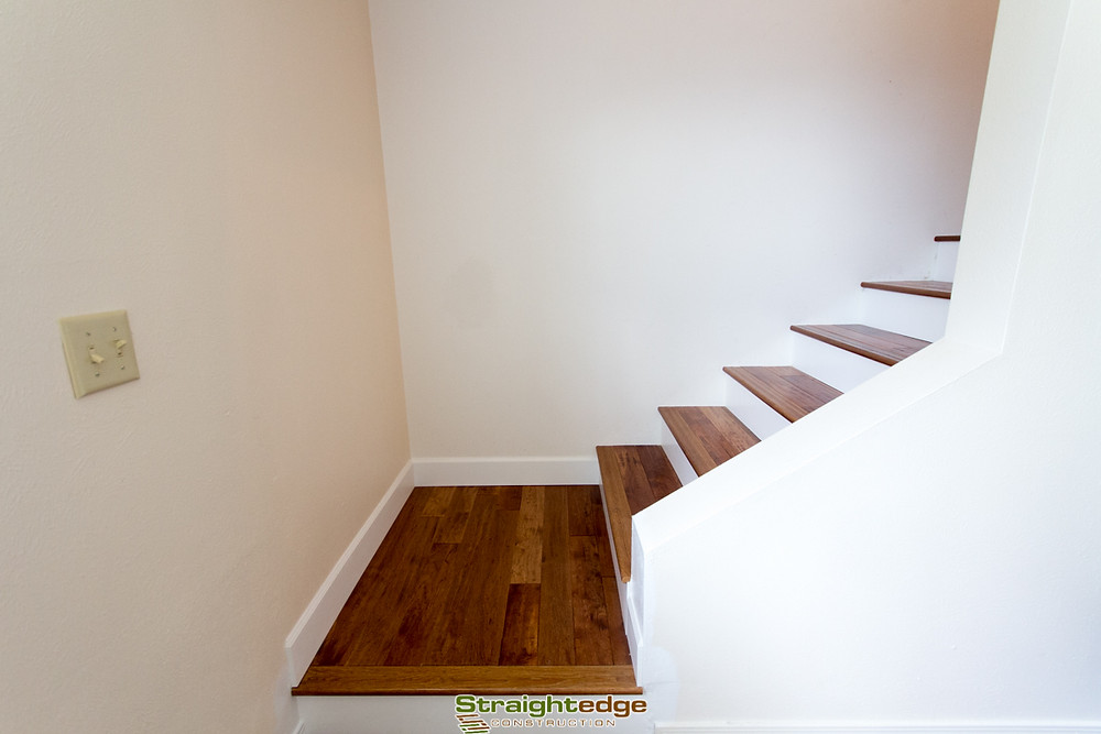 hardwood floating stairs done by Straightedge Contruction