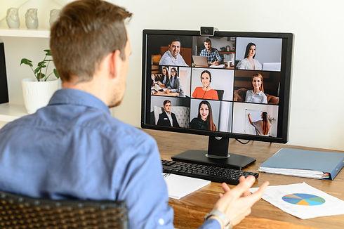 man attending Zoom meeting