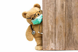 Brown teddy bear doctor with protective