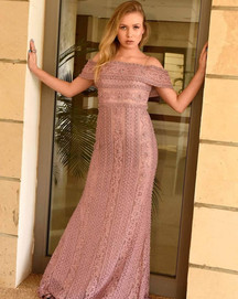 A light purple beaded evening dress with bare shoulders