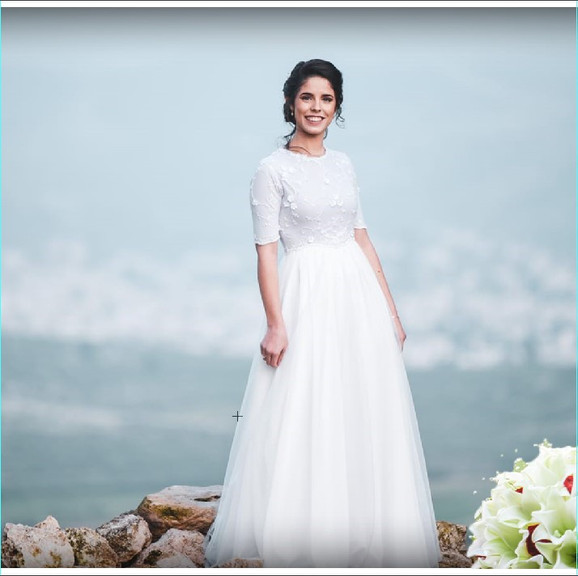 Modest wedding dress with delicate tulle and 3/4 sleeve