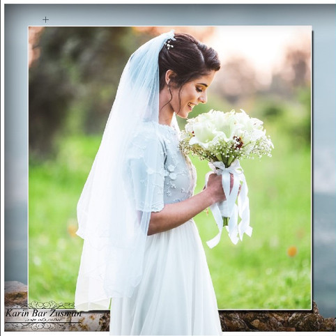 A modest and delicate wedding dress with a delicate tulle