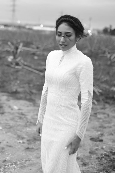 A modest beaded wedding dress full of sculpted lining