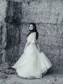 Shimmering wedding dress with batwing sleeves and a flimsy skirt