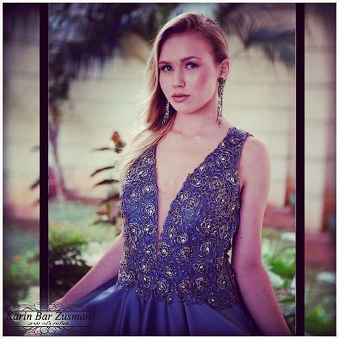 A beaded blue princess evening gown