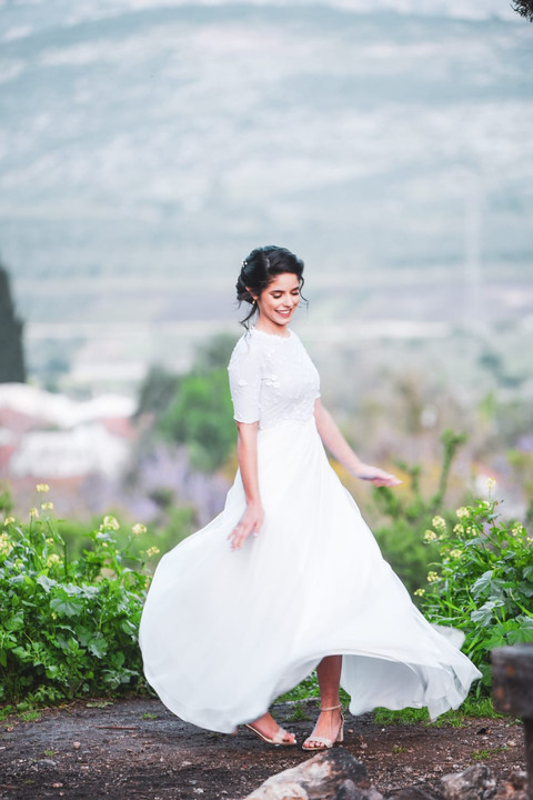 Modest wedding dress with delicate tulle and delicate flowers