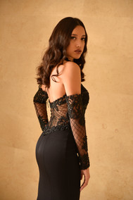 A tight evening dress with a trail