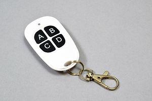 Brickstuff 4-button white RF remote control transmitter.