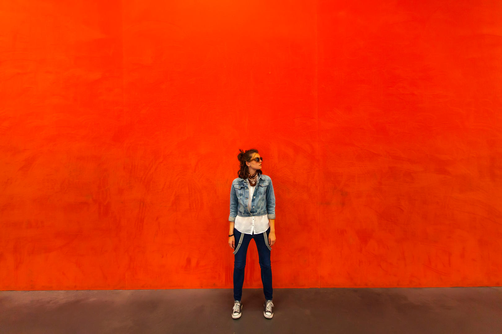 Woman against red wall