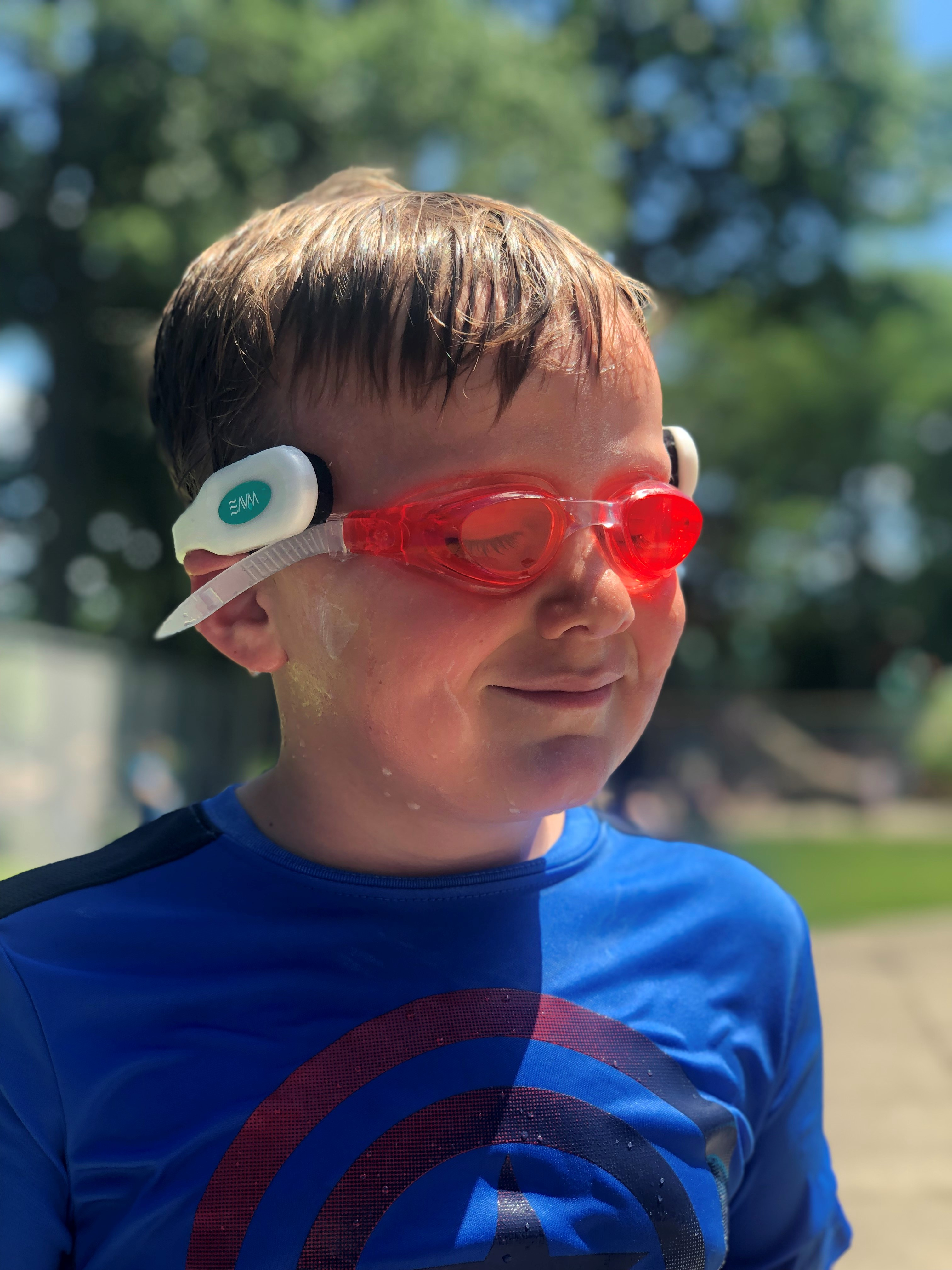 Boy wearing WAVE Drowning Detection Tracker Wearable