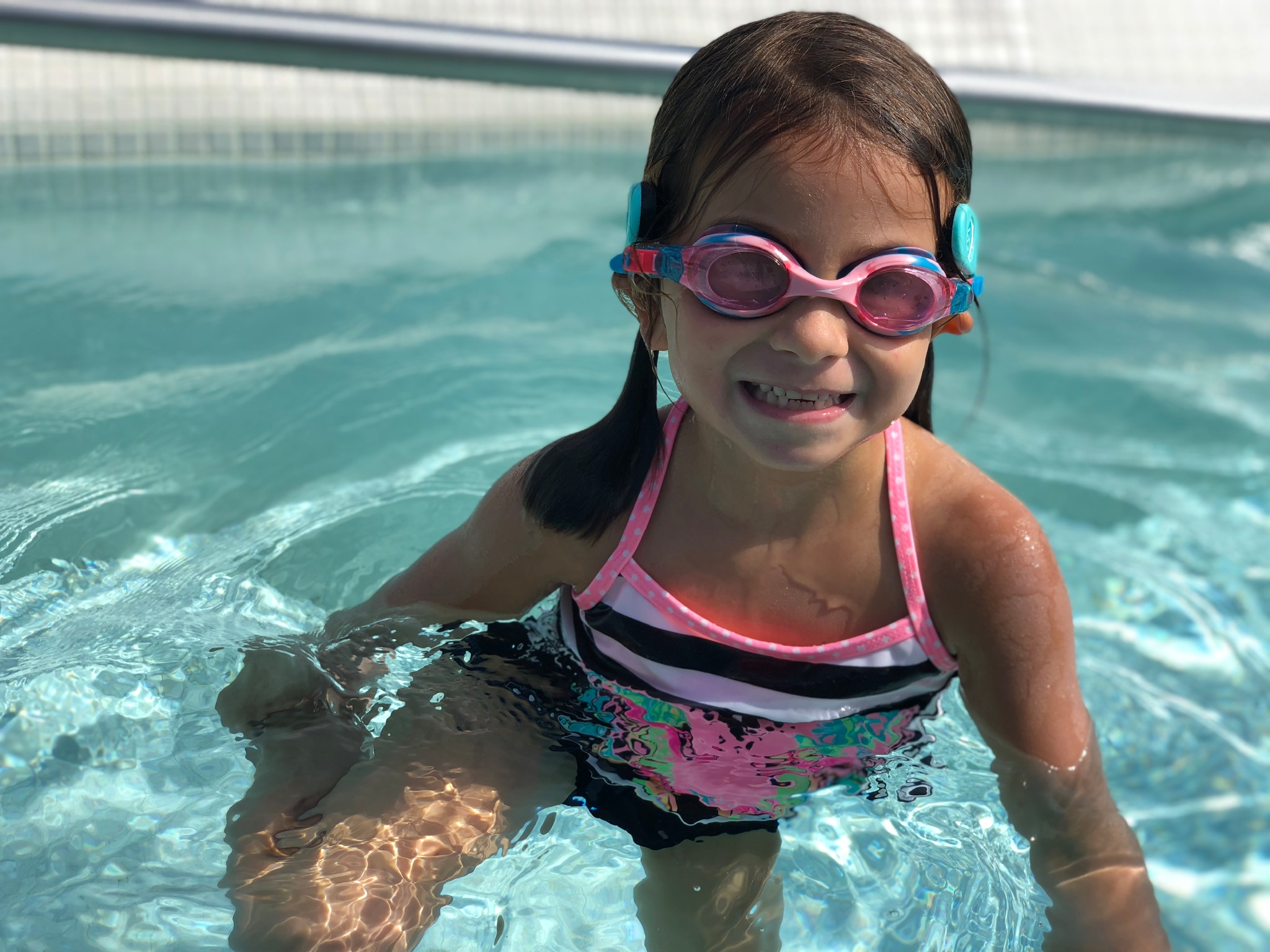 Girl wearing WAVE Drowning Detection System w20 Wearable