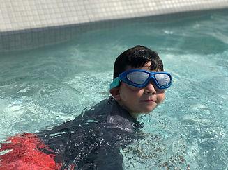 Boy w Large Goggles in pool2.jpeg
