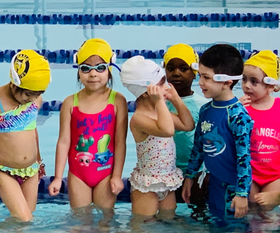 Toddlers wearing WAVE Drowning Prevention System Wearables