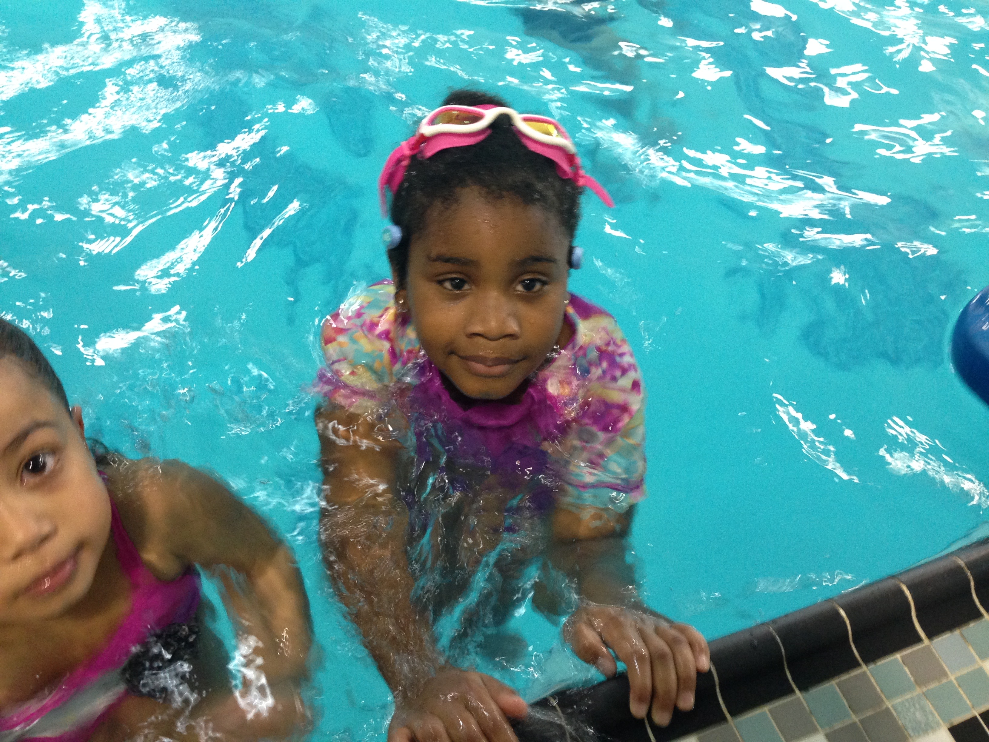 Young girl wears WAVE Pool Alarm Wearable