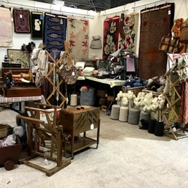 Vintage rugs and sewing boxes plus other treasures on my stand at Wonderwool Wales