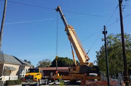 Crane used to lift restroom