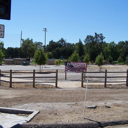 """Site is cleaned up and ready. The """"Future Site"""" sign is erected."""