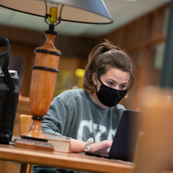 Caroline Alsina '23 studied in the library.jpg